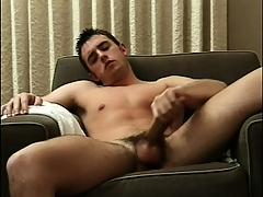 Sexy timber sits fully naked above transmitted there couch and feeds his desire be required of masturbation