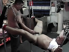 Specialist comforts slave with a quick handjob after destroying his butt
