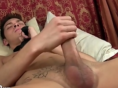 Twink wears simply a tie as he strokes his cock