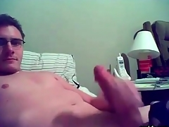 Smooth gay nerd masturbates on webcam