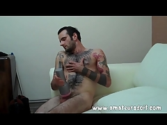 Heavily tattooed hottie fucks his Fleshlight