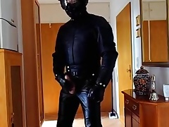 Biker wearing from beginning to end Aged Climate Leathersuit