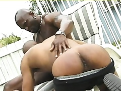 Muscled black deny stuff up gives his ebon lover a deep anal pounding outside